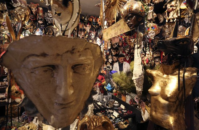 "Iranian mask artisan Hamid works in his shop ""Ca' del Sol"" near St. Mark's square during the first day of carnival in Venice February 1, 2015. (Photo by Stefano Rellandini/Reuters)"