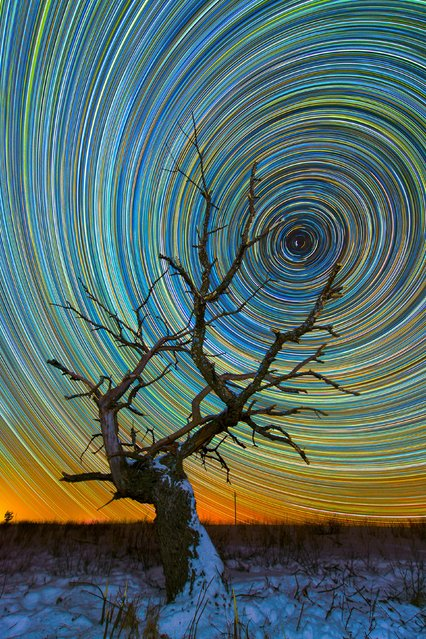 Vibrate, colorful star trails over a snowy field. (Photo by Evgeniy Zaytsev/Caters News)