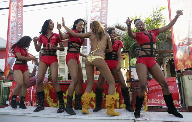 Models dance during Carnival celebrations in Port of Spain February 16, 2015. (Photo by Andrea De Silva/Reuters)