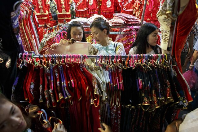 Women buy clothes ahead of the Chinese Lunar New Year celebrations in Bangkok's Chinatown February 17, 2015. (Photo by Athit Perawongmetha/Reuters)