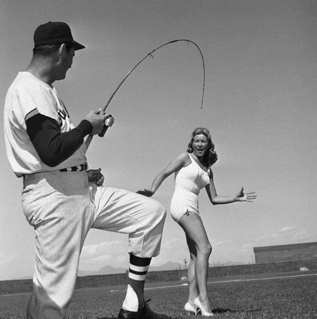 Ardent fisherman Ted Williams of the Boston Red Sox appears to have hooked Frances Flajnik, Tempe queen of Anglers World Series, March 15, 1960. (Photo by AP Photo)