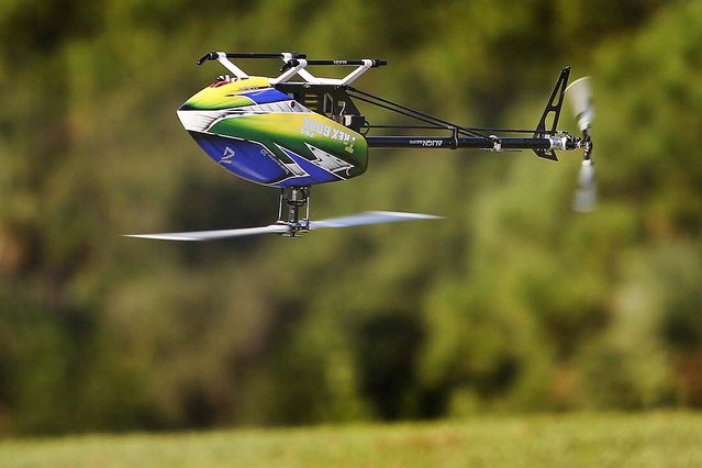 A T-Rex 600 Efl remote control helicopter flown by Jeff Polisena of West Palm Beach does acrobatic maneuvers at Phil Wherry Field. (Photo by Bill Ingram/The Palm Beach Post)