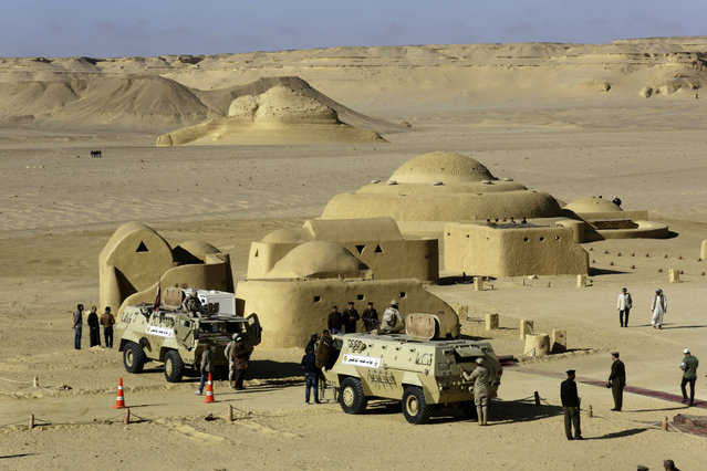 Egyptian Army vehicles stand outside the Wati El Hitan Fossils and Climate Change Museum, a UNESCO natural World Heritage site, on the opening day, in the Fayoum oasis, Egypt, Thursday, January 14, 2016. (Photo by Thomas Hartwell/AP Photo)