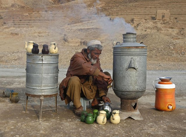 An Afghan man prepares tea for customers at a roadside tea shop on the outskirts of Jalalabad February 2, 2015. (Photo by Reuters/Parwiz)