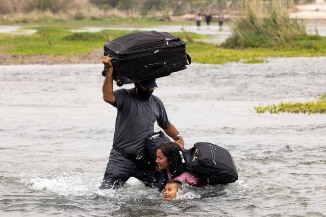Asylum-seeking migrants from Venezuela cross the Rio Grande into the United States from Mexico, in Del Rio, Texas, May 10, 2021. (Photo by James Breeden/Reuters)