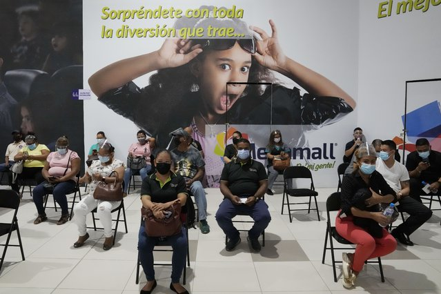 Residents sit in observation after getting shots of the AstraZeneca vaccine for COVID-19 at Mega Mall on the outskirts of Panama City, Wednesday, June 9, 2021. (Photo by Arnulfo Franco/AP Photo)