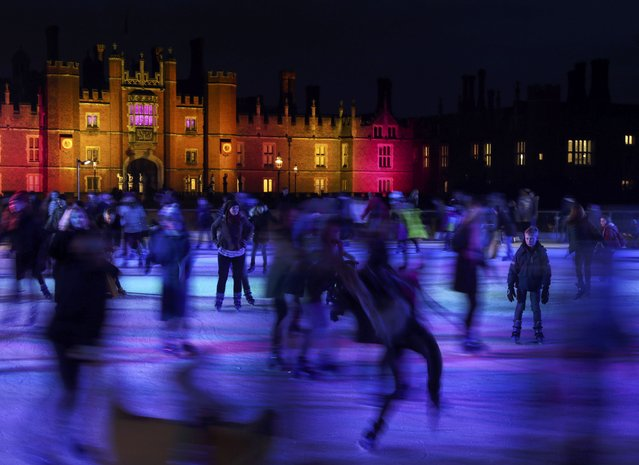 People skate on the ice rink at Hampton Court Palace in London, Britain December 20, 2016. (Photo by Eddie Keogh/Reuters)
