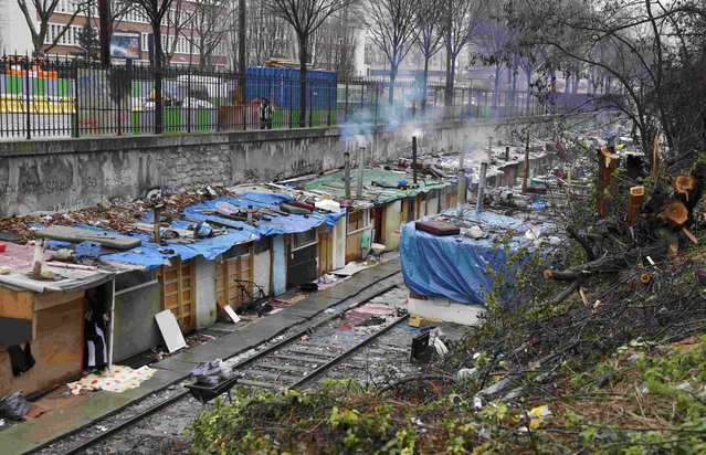A view shows a Romani camp installed along La Petite Ceinture, an abandoned railroad line, in Paris, France, February 2, 2016. More than 350 Roma people, who have been living here since the last summer, face eviction from the makeshift camp this week. (Photo by Jacky Naegelen/Reuters)