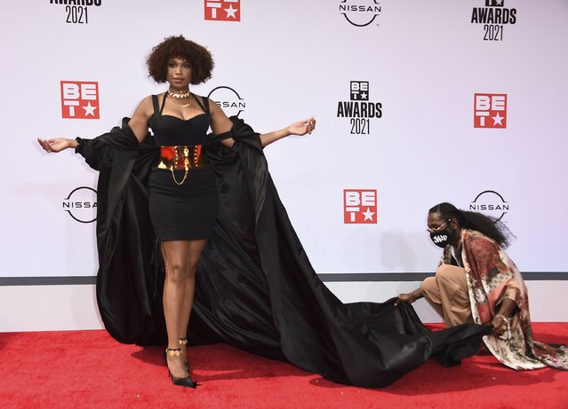 An assistant helps with Jennifer Hudson's outfit as she poses at the BET Awards on Sunday, June 27, 2021, at the Microsoft Theater in Los Angeles. (Photo by Jordan Strauss/Invision/AP Photo)