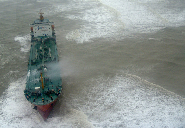 A vessel is stranded near the coast of Lingao, south China's Hainan province, September 24, 2007. The vessel ran aground after tropical storm Francisco made landfall in Hainan. (Photo by Reuters/China Daily)