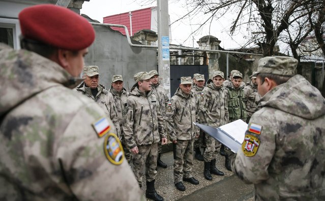 Members of the People's Militia of Crimea line up before patrolling the territory, during preparations for the first anniversary of the Crimean referendum to secede from Ukraine and join Russia, in Simferopol, March 13, 2015. (Photo by Maxim Shemetov/Reuters)