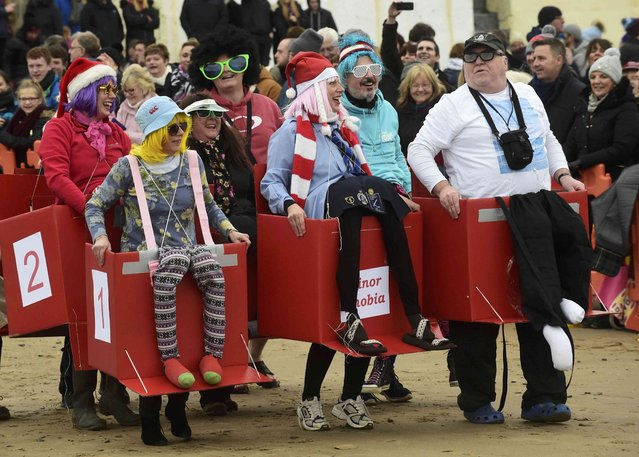 Competitors arrive in fancy dress before taking part in the New Year's Day swim at Saundersfoot in Wales, Britain, January 1, 2017. (Photo by Rebecca Naden/Reuters)