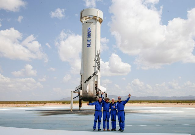 Billionaire American businessman Jeff Bezos (2nd-L) poses for pictures with crew mates, from left, Oliver Damen, 18, Bezos, Wally Funk, 82, and Mark Bezos at the landing pad after they flew on Blue Origin's inaugural flight to the edge of space, in the nearby town of Van Horn, Texas, U.S. July 20, 2021. (Photo by Joe Skipper/Reuters)