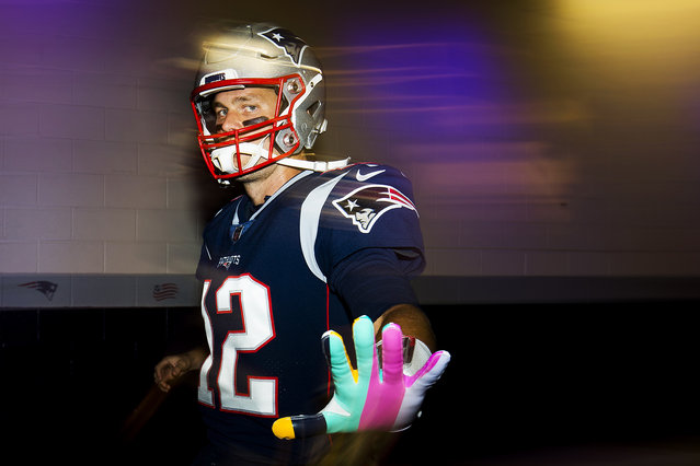 Tom Brady #12 of the New England Patriots walks through the tunnel towards the field before a game against the Kansas City Chiefs at Gillette Stadium on October 14, 2018 in Foxborough, Massachusetts. (Photo by Adam Glanzman/Getty Images)