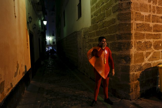 A reveller in fancy costume drinks during the Carnival of Cadiz, southern Spain February 9, 2016. (Photo by Marcelo del Pozo/Reuters)