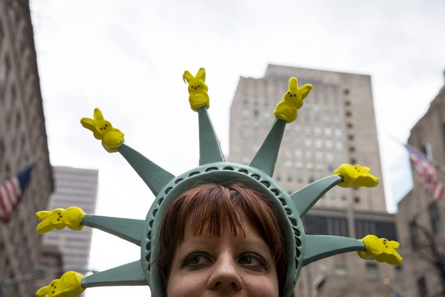 A woman dressed in costume attends the Easter Parade and Bonnet Festival along 5th Avenue in New York City April 5, 2015. (Photo by Eric Thayer/Reuters)