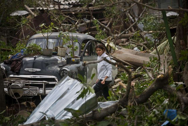 A woman recovers her valuables after her house destroyed by the force of the tornado in Regla, Cuba, Monday, January 28, 2019. (Photo by Ramon Espinosa/AP Photo)