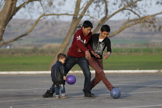 Migrants play with a ball at a petrol station near the town of Polikastro, Greece February 23, 2016. (Photo by Marko Djurica/Reuters)