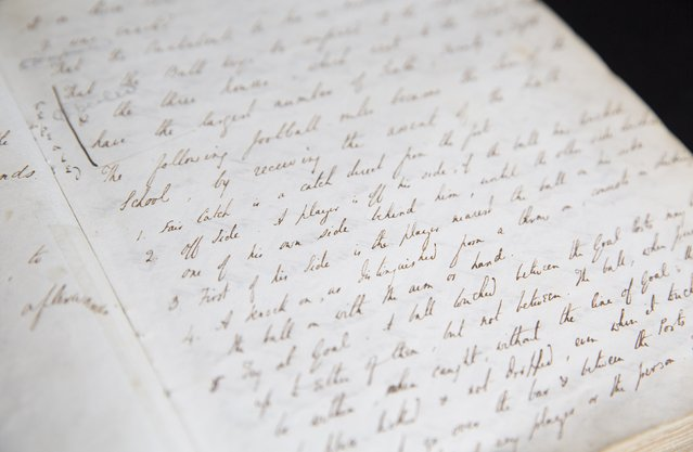 The first handwritten rules for rugby football, dated August 28, 1845, are seen in a pupil's minutes book at Rugby School in central England, March 18, 2015. (Photo by Neil Hall/Reuters)