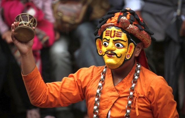 """A masked dancer performs as part of """"Devi Pyankha"""" (Devi Dance) to mark the beginning of the Indra Jatra Festival in Kathmandu, Nepal on September 15, 2021. Nepali celebrate the Indra Jatra festival to worship """"Indra"""", the god of rain and to mark the end of monsoon season. (Photo by Sunil Sharma/ZUMA Press Wire/Rex Features/Shutterstock)"""
