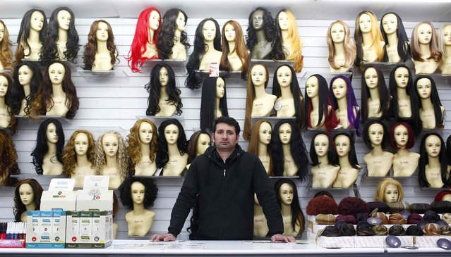 "Kashir Mir, 34, poses for a photograph at his workplace, Juliet Wig Shop, in the London constituency of Brent Central, Britain, April 13, 2015. Mir, who was born in Pakistan, said: ""I will vote but it's a secret. I also hope they can manage immigration better as I have been stopped and interviewed for hours returning from Pakistan. I'm an honest man, working here and paying my tax"". (Photo by Eddie Keogh/Reuters)"