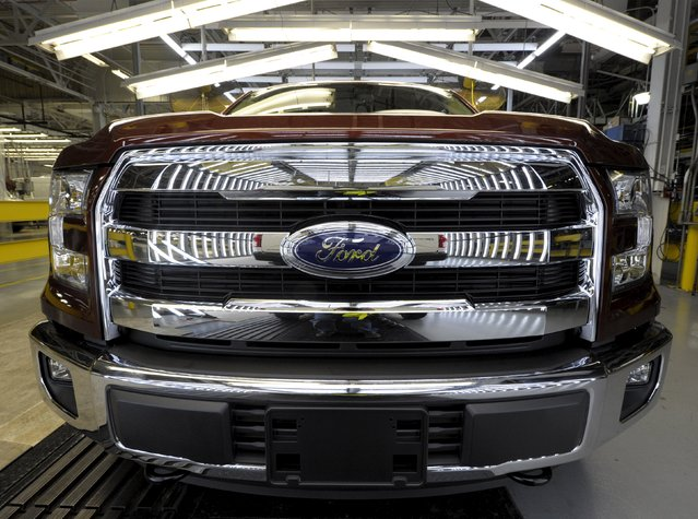 The front grill of a finished Ford F150 pickup reflects the inspection light on the final line of Ford's Kansas City Assembly Plant where new aluminum intensive Ford F-Series pickups are built in Claycomo, Missouri May 5, 2015. (Photo by Dave Kaup/Reuters)