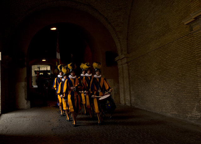 Vatican Swiss guards march after a swearing-in ceremony, at the Vatican, Wednesday, May 6, 2015. (Photo by Ettore Ferrari/AP Photo/Pool Photo)
