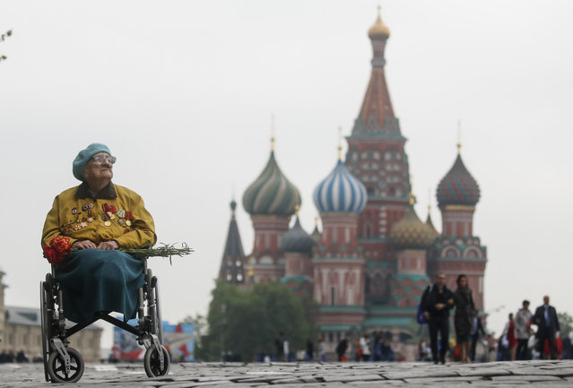A veteran sits in a wheelchair in front of St. Basil's Cathedral after the Victory Day parade, which marks the anniversary of the victory over Nazi Germany in World War Two, in Red Square in central Moscow, Russia May 9, 2019. (Photo by Maxim Shemetov/Reuters)