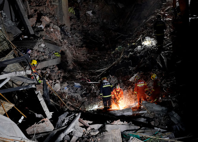 Firefighters work at the site where a building collapsed, in Shanghai, China on May 16, 2019. (Photo by Aly Song/Reuters)