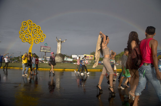Members of LGBT organizations take part in a march marking International Day Against Homophobia, in Managua, Nicaragua, Sunday, May 17, 2015. (Photo by Esteban Felix/AP Photo)