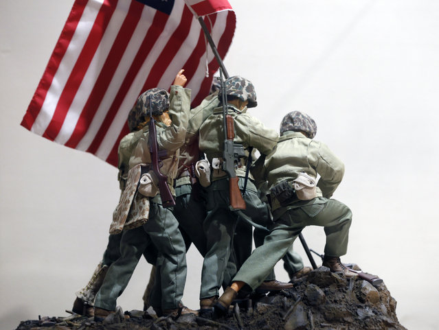 In this January 31, 2014 photo, G.I. Joe action figures portray Raising the Flag on Iwo Jima in a display at the New York State Military Museum in Saratoga Springs, N.Y. (Photo by Mike Groll/AP Photo)