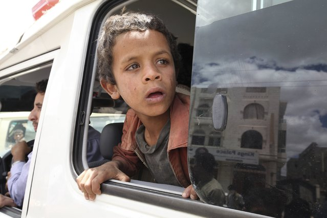 A boy looks out of the window of a Yemen Red Crescent vehicle as he leaves an underground water tunnel with other displaced people, after they were forced to flee their home due to ongoing air-strikes carried out by the Saudi-led coalition in Sanaa May 2, 2015. (Photo by Mohamed al-Sayaghi/Reuters)