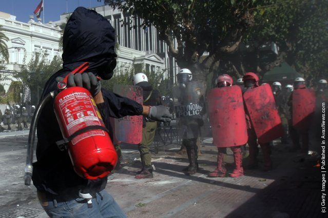 Demonstrators clashes with police during a protest against plans for new austerity measures in Athens, Greece