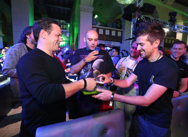 IMAGE DISTRIBUTED FOR MICROSOFT -Phil Spencer, Head of Xbox, interacts with gamers at the Xbox Media Showcase at E3 in Los Angeles on Monday, June 15, 2015. (Photo by Casey Rodgers/Invision for Microsoft/AP Images)