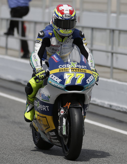 Switzerland's Dominique Aegerter steers his Kalex after the Moto 2 qualifying for the motorcycle GP in Montmelo, Spain, Saturday, June 13, 2015. The Catalunya Grand Prix will take place on Sunday in Montmelo. (AP Photo/Manu Fernandez)
