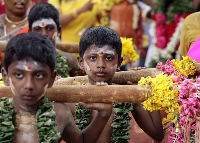 """Young Hindu boys attend a religious procession to celebrate """"Aadi Kiruthigai"""", a festival dedicated to Hindu god Murugan, at a temple in Chennai, India, July 26, 2019. (Photo by P. Ravikumar/Reuters)"""