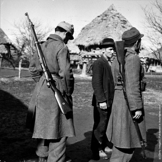 1952:  A deserter from the army being escorted by two members of the military police. Desertions are frequent in Iran where the population is not accustomed to organised militarism