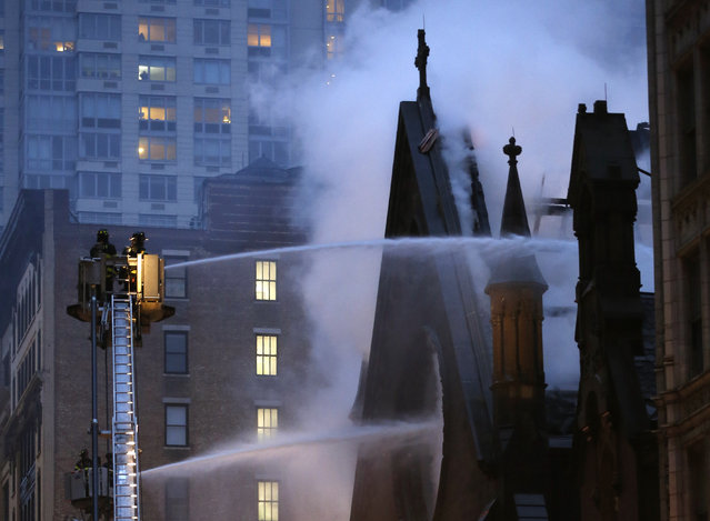 Firefighters battle a fire at the historic Serbian Orthodox Cathedral of St. Sava, Sunday, May 1, 2016, in New York. The church that was constructed in the early 1850s and was designated a New York City landmark in 1968. (Photo by Kathy Willens/AP Photo)