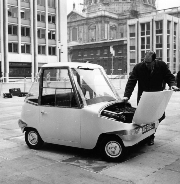 "A man inspecting the engine of his miniature, motorised car, ""The Scamp"". 1966. (Photo by Evening Standard/Getty Images)"