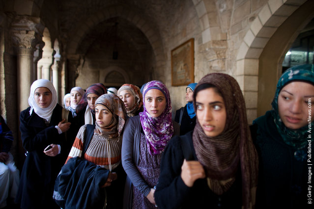Palestinian Muslim schoolgirls visit the Church of the Nativity in Bethlehem