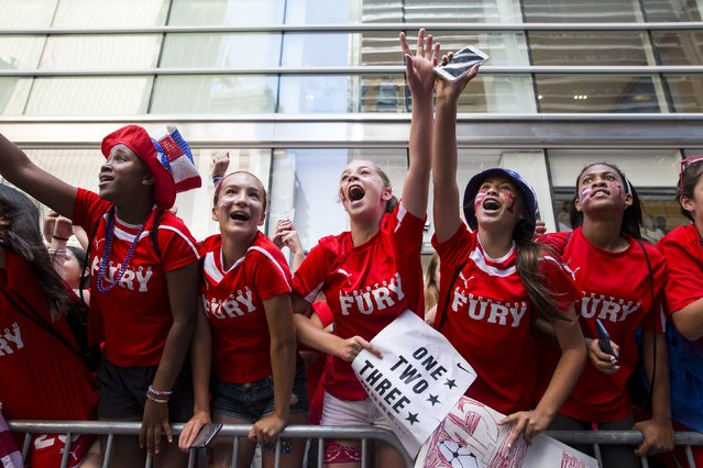Fans of the U.S. women's soccer team cheer during the ticker tape parade to celebrate their World Cup final win over Japan on Sunday, in New York, July 10, 2015. (Photo by Andrew Kelly/Reuters)