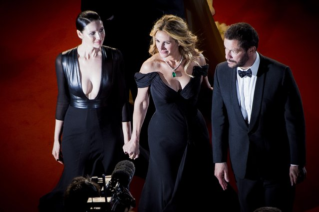 """Julia Roberts, Dominic West and Caitriona Balfe attend the screening of """"Money Monster"""" at the annual 69th Cannes Film Festival at Palais des Festivals on May 12, 2016 in Cannes, France. (Photo by Francois Durand/Getty Images)"""