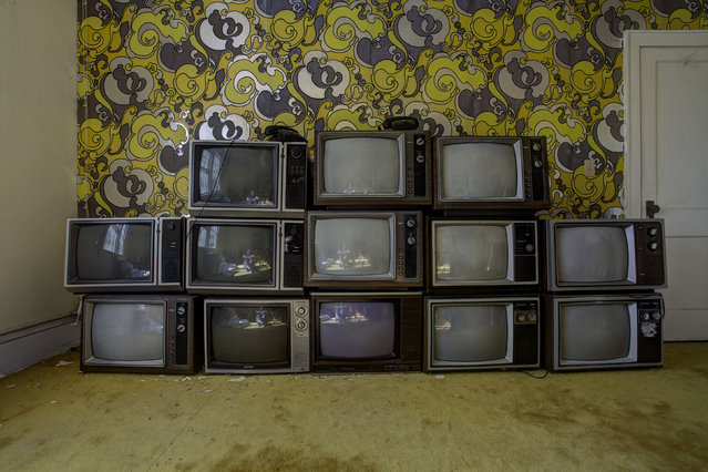 Stacked televisions in an old hotel somewhere in New York. (Photo by Daniel Barter/Caters News)