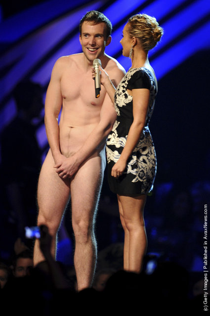 Hayden Panettiere and guest onstage during the MTV Europe Music Awards 2011 live show at at the Odyssey Arena