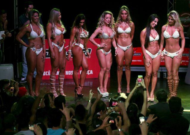 Competitors are seen during the 2015 Brazil Miss and Mister Fitness contest in Sao Paulo, Brazil, June 18, 2015. Some 96 men and women from all across the country competed in the event. (Photo by Paulo Whitaker/Reuters)