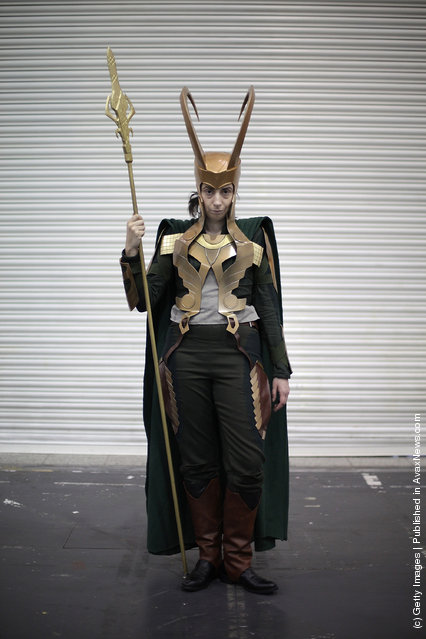 A visitor to the London Super Comic Convention dresses as Loki at ExCel