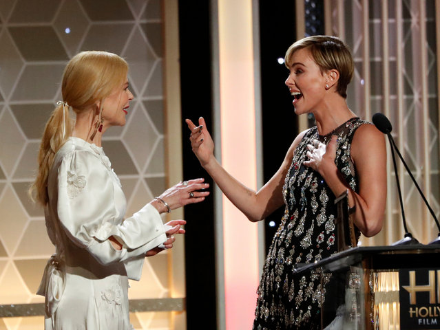 Nicole Kidman (left) presents Charlize Theron with the career achievement prize at the annual Hollywood film awards in Beverly Hills, US on November 3, 2019. (Photo by Mario Anzuoni/Reuters)
