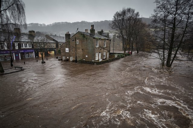 Floods in West Yorkshire, UK, by Steve Morgan. On Boxing Day 2015, a thriving former mill town in the Calder valley, Hebden Bridge, was flooded. Sirens echoed around the valley at 7.30am alerting sleeping residents to the rising waters about to engulf the town. (Photo by Steve Morgan/2016 Atkins CIWEM Environmental Photographer of the Year)