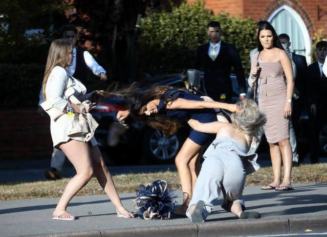 Three young women in their 20s brawling on a busy street on the route from the track to the town centre during day four of the William Hill St Leger Festival at Doncaster Racecourse, England on September 14, 2019. (Photo by Nb press ltd)