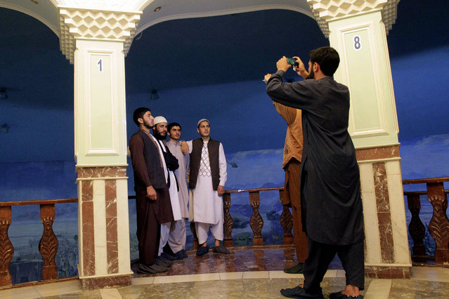 In this Friday, April 17, 2015 photo, Afghans pose for a photograph at the Jihad Museum in Herat city, west of capital Kabul, Afghanistan. (Photo by Massoud Hossaini/AP Photo)